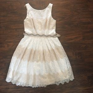 White and cream lace dress with beaded belt.Size 8